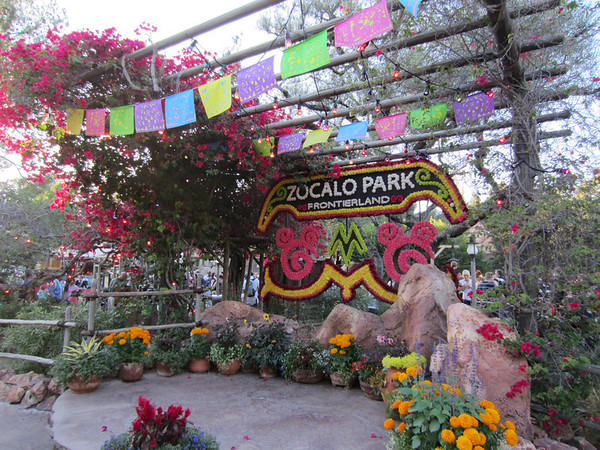 Celebrating El Dia de Los Muertos with lots of skeletons and colorful decorations.