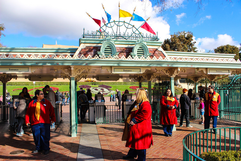 If you purchase multi-day tickets, these cast members are taking your picture with a small cell phone like device before you enter the parks.This is to fight multi-day ticket scammers who buy tickets for several days and
