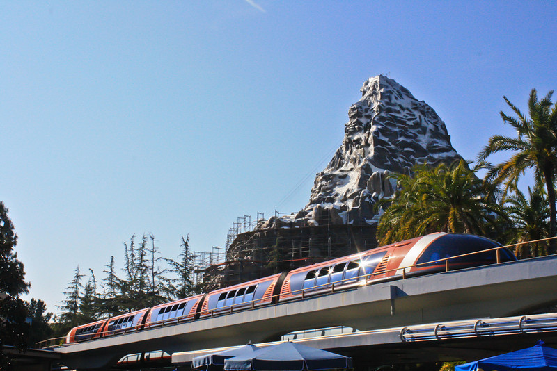 Monorail Orange pulling into Tomorrowland Station.