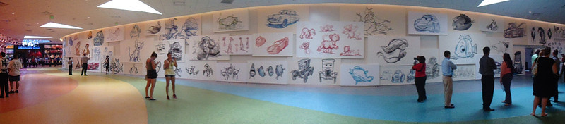 Wall opposite the front desk, showing concept art for the main characters of all four films. You can even catch a glimpse of British Sabastian!
