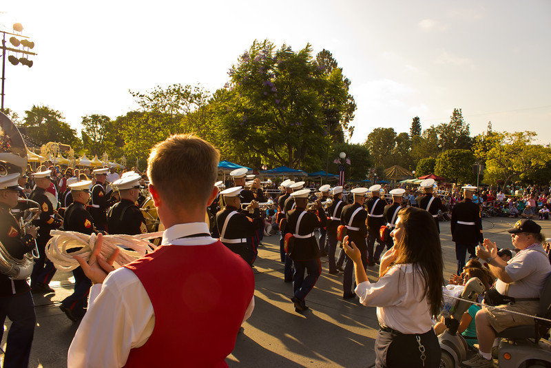 Even cast members pause a moment to cheer on the band.