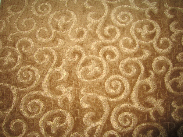 The carpeting in the room features a pattern chock full of hidden Mickeys.