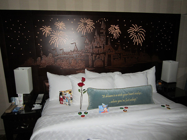 The headboard all lit up.  At night, the hotel has a turn down service.  They leave you chocolates on your pillow. (The roses were for a special celebration and aren't normally provided.)