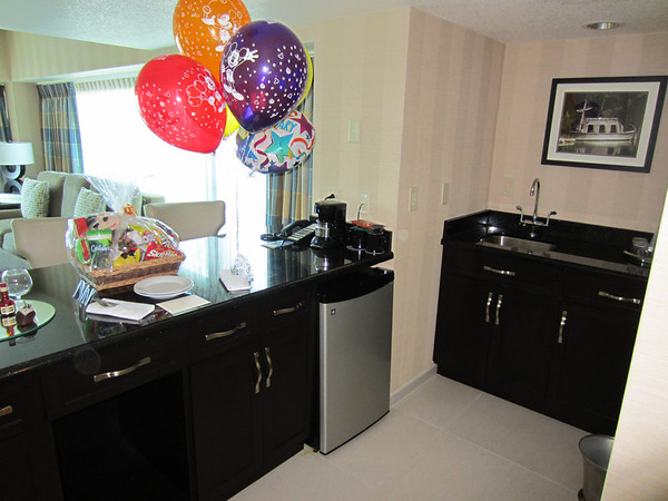 The kitchen features a refrigerator and sink. (The basket and balloons were bought separately for a special occasion.  They are not included, but were delivered through Disney's Gift Services and waiting in the room.)