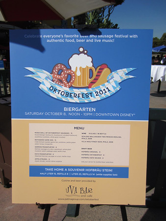 Menu includes a selection of German foods including various sausages, game hen, and