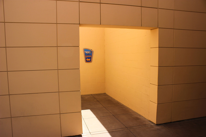 Entrance to Turtle Talk with Crush next to the restrooms in between Off the Page and Disney JR on Stage.