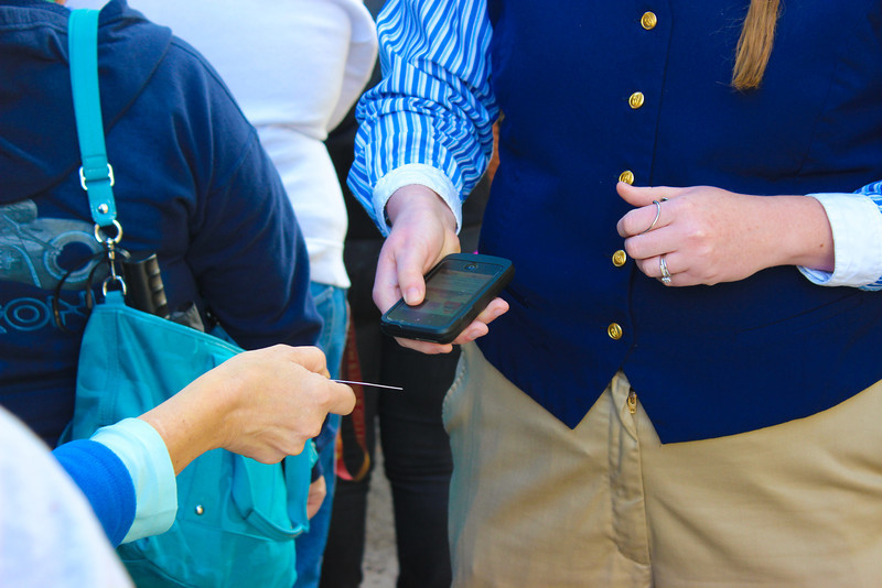 Cast members are using Apple devices for a large variety of tasks from taking photos of guests with mult-day passes to scanning pass holders in for an exclusive sneak peak of Princess Fantasy Faire.